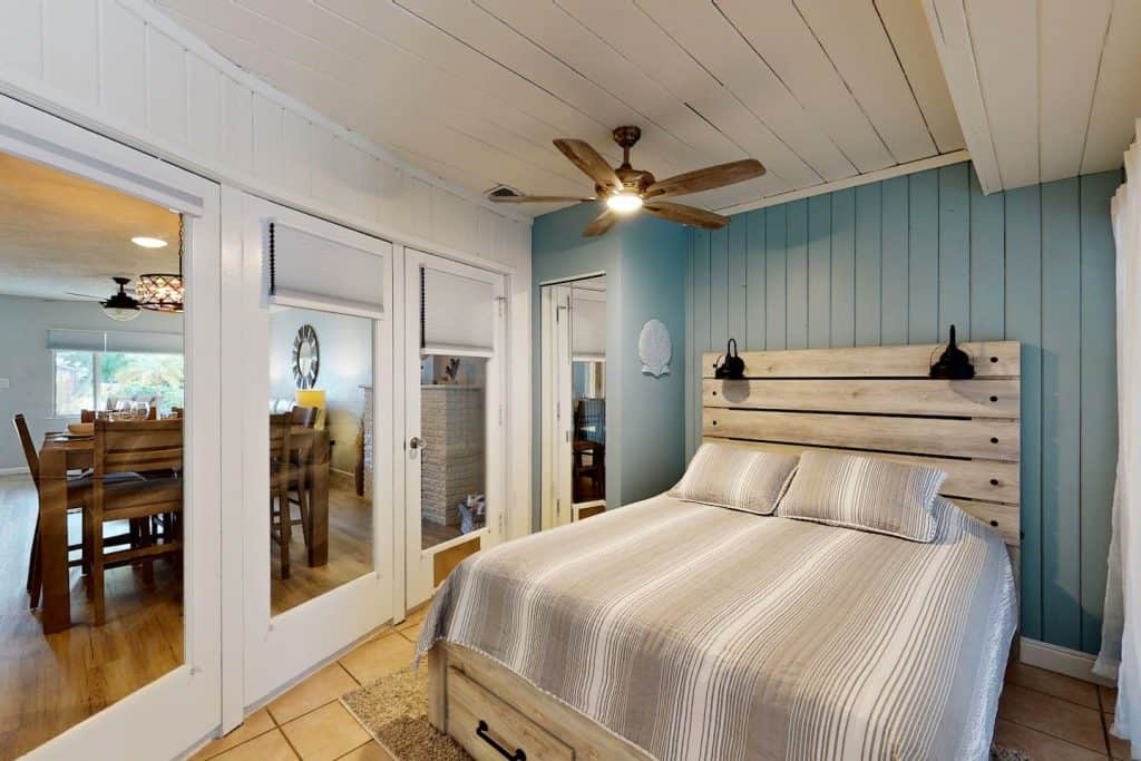 Photo of a coastal chic bedroom inside an Airbnb in Sarasota.