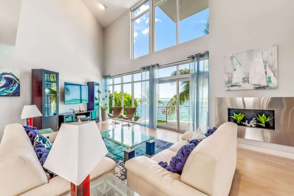Photo of the living room with a beach view inside the Modern Marvel Airbnb property in Sarasota.