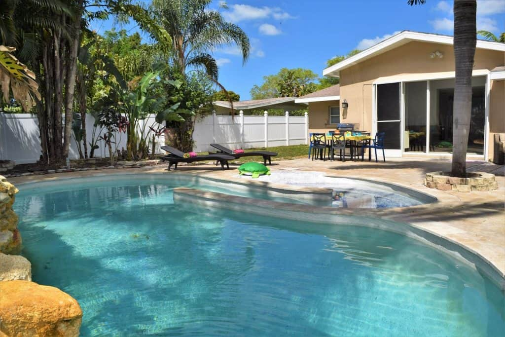 Photo of the pool and backyard at an Airbnb in Sarasota.