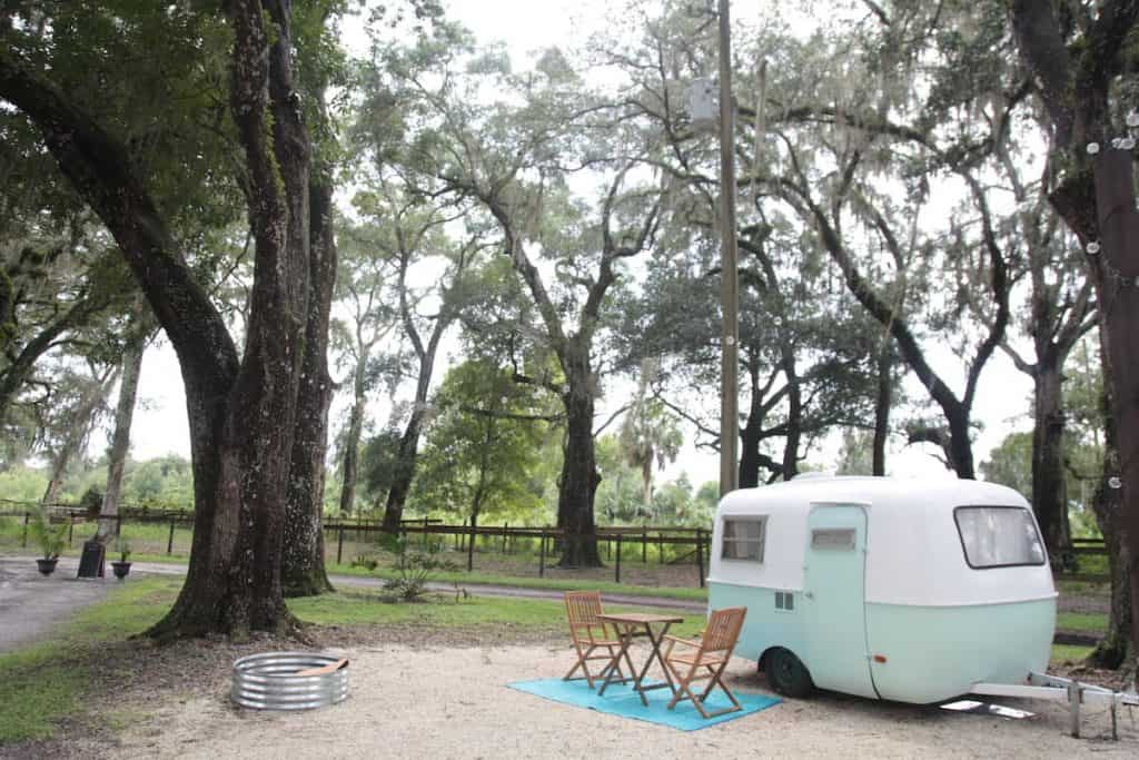 Check out this vintage camper that sleeps two at Enchanted Farms.