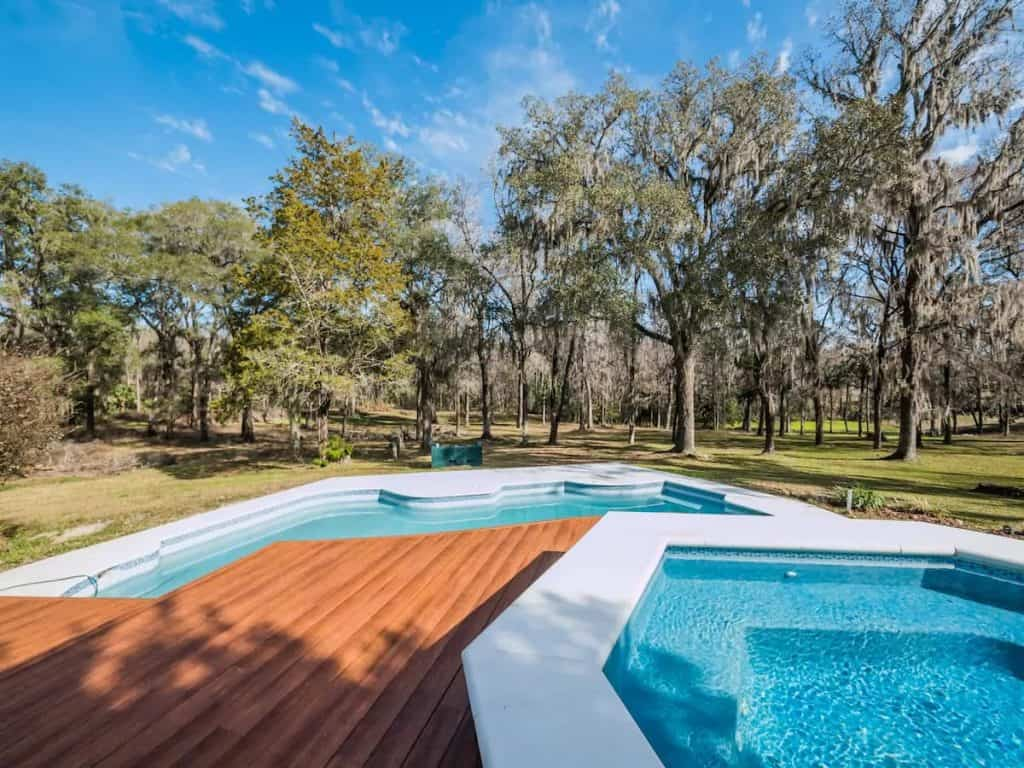 Come stay at this spectacular  vacation rental in nearby reddick complete with salt water pool