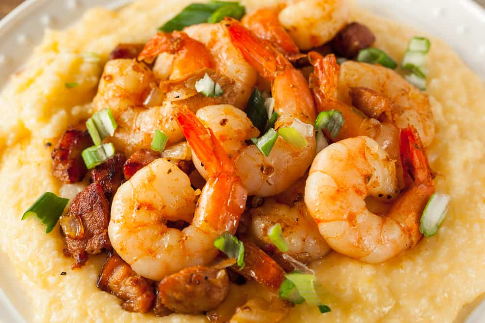 Try the shrimps n' grits at the Conch House a Caribbean style restaurant on the water