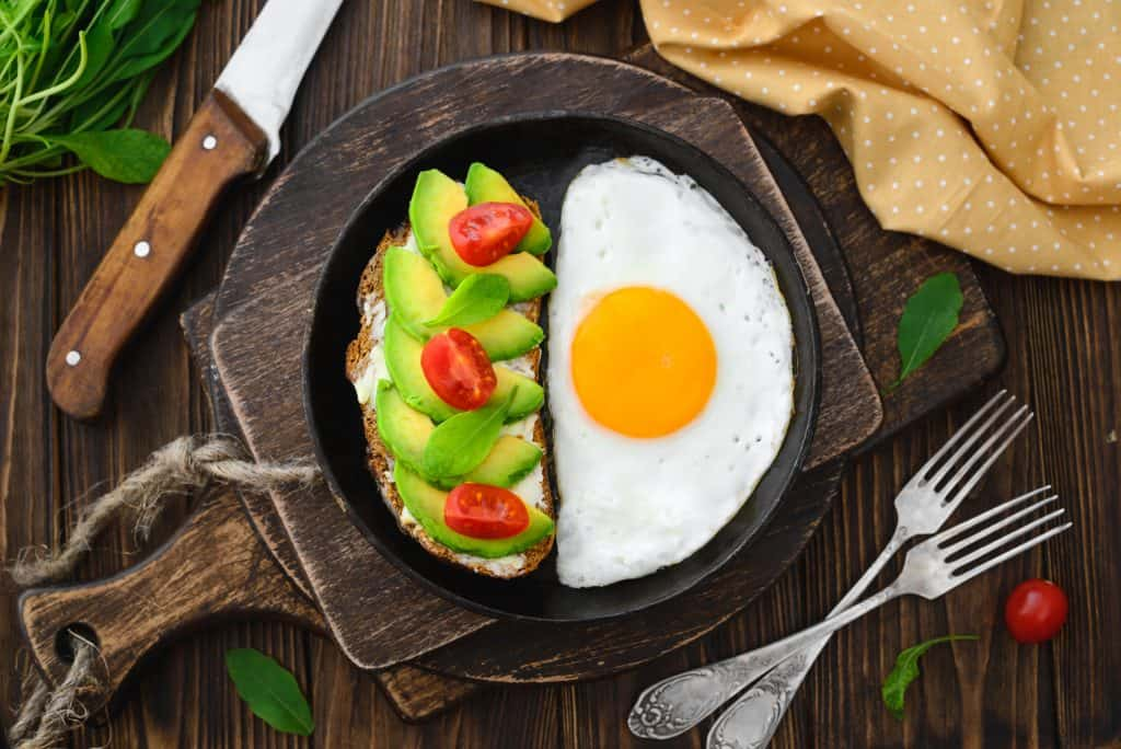 Avocados and an egg sit in a skillet, perfect for breakfast in Key West.