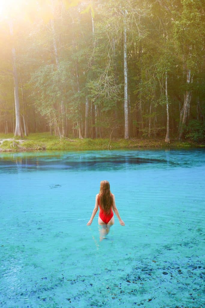 Wading through the cool crisp waters of Gilchrist Blue Springs.