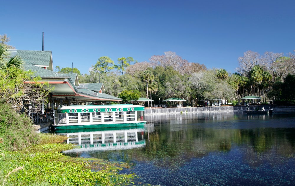 A riverboat sits on the waters of Silver Springs, one of the best Florida springs with camping.