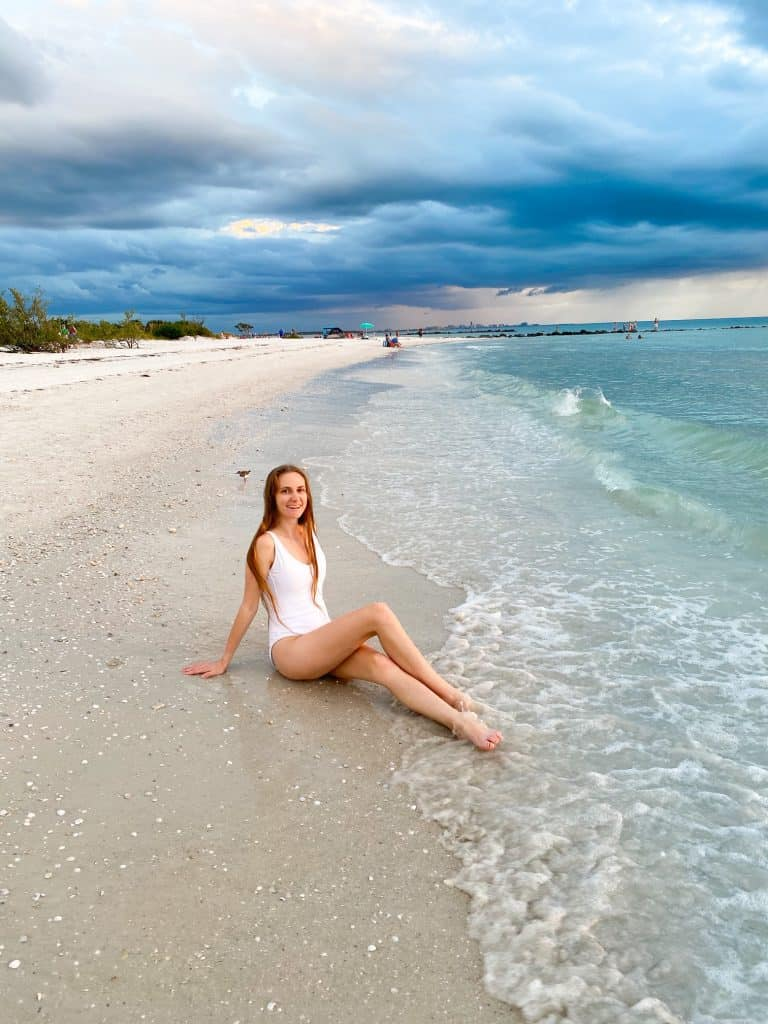 sitting and smiling on North Beach in honeymoon Island