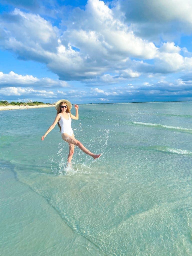 splashing in the water at honeymoon Island State park