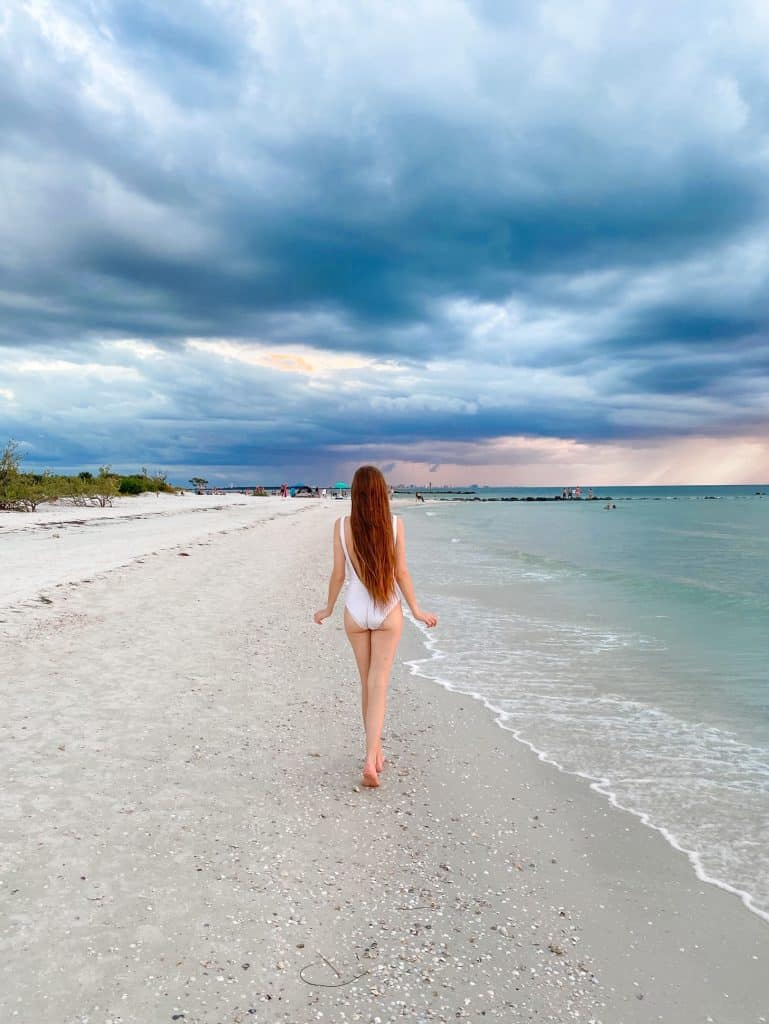 walking away into a storm at honeymoon Island