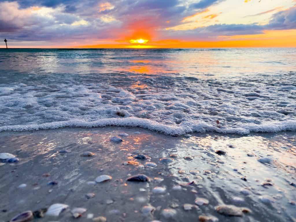 sunset along the water at honeymoon Island