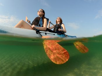 A tandem kayak paddles through Florida waters.