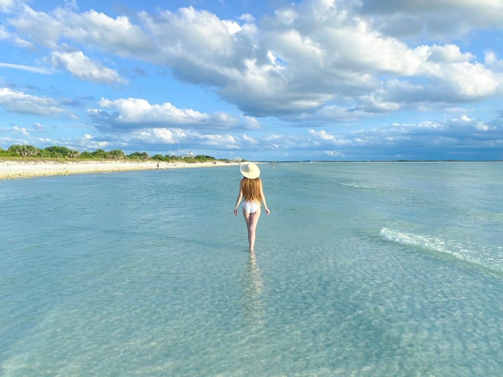 Walking through the shallow waters of Honeymoon Island, perfect for kayaking in Florida.