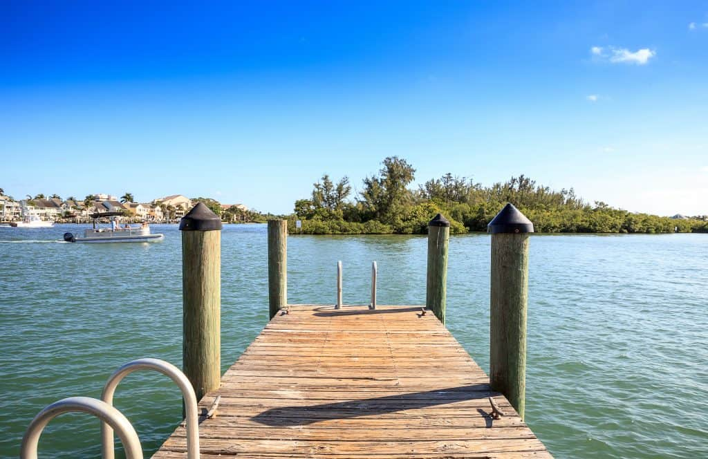 A dock looks out onto the gentle waters of Sawfish Bay Park.