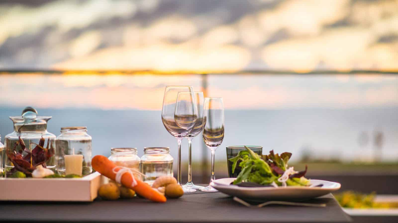 A table is set for dinner overlooking the waters of Dunedin.