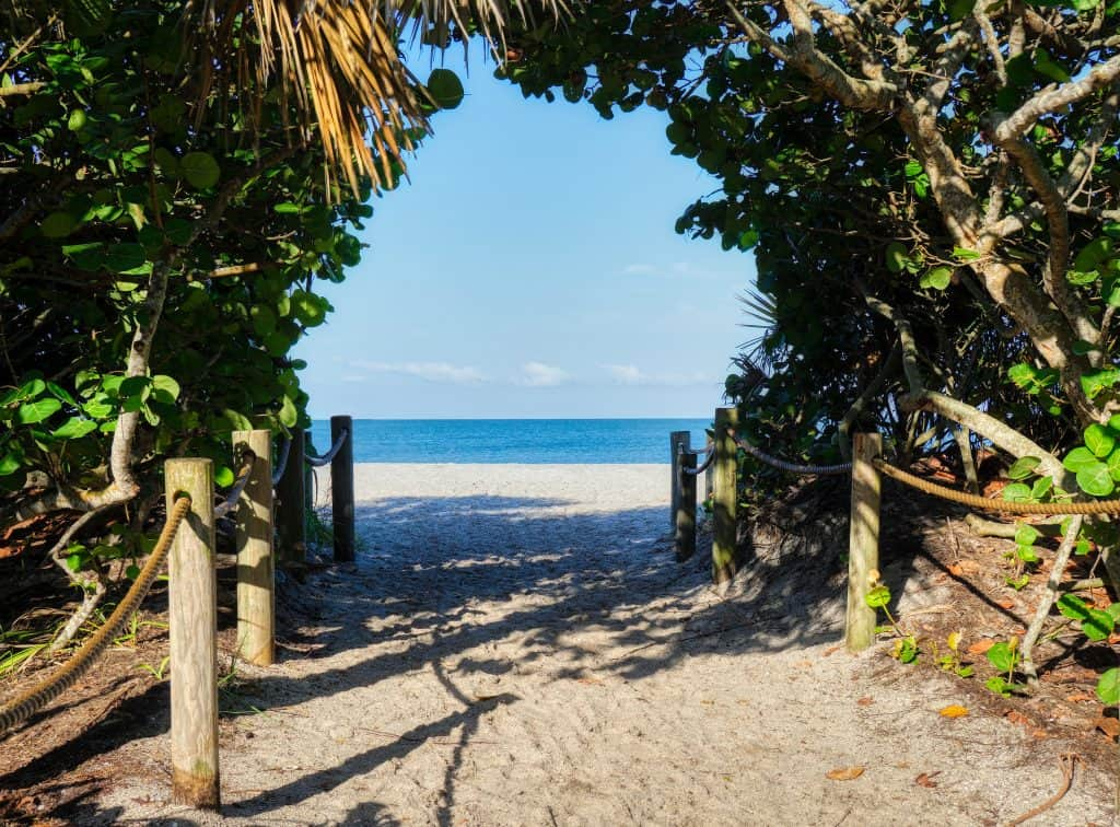 Mangroves and tropical trees create a tunnel that leads to the waters of Sanibel Island beaches.