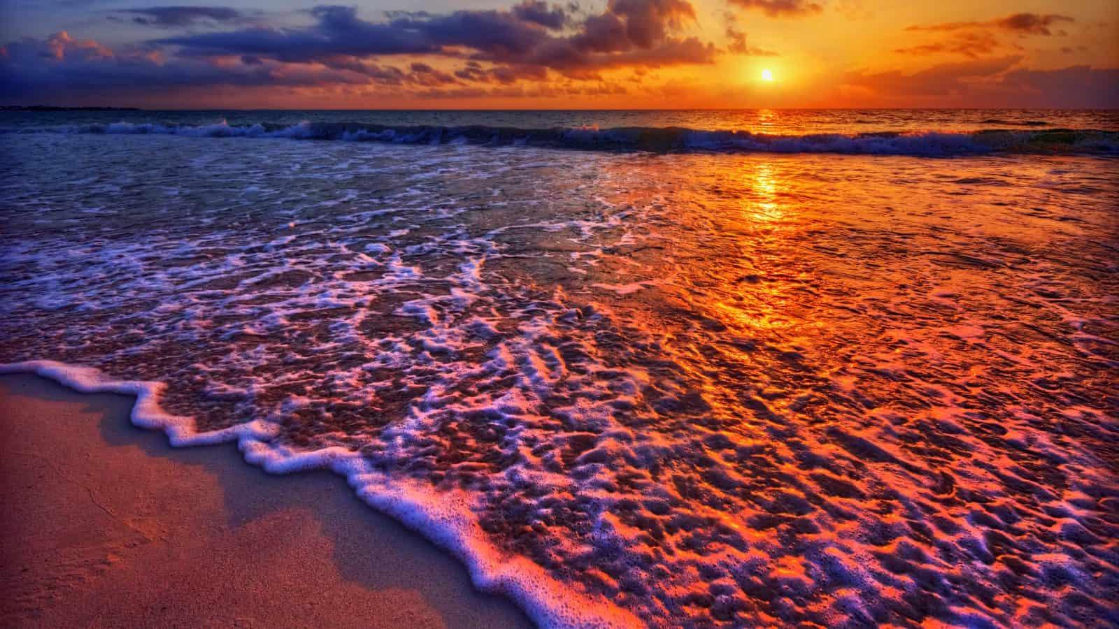 The sun sets on the shoreline of Sanibel Island.