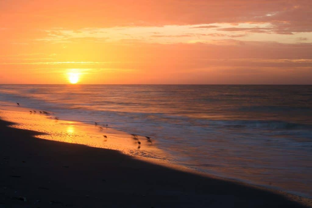The sun sets on Tarpon Bay Beach on Sanibel Island.