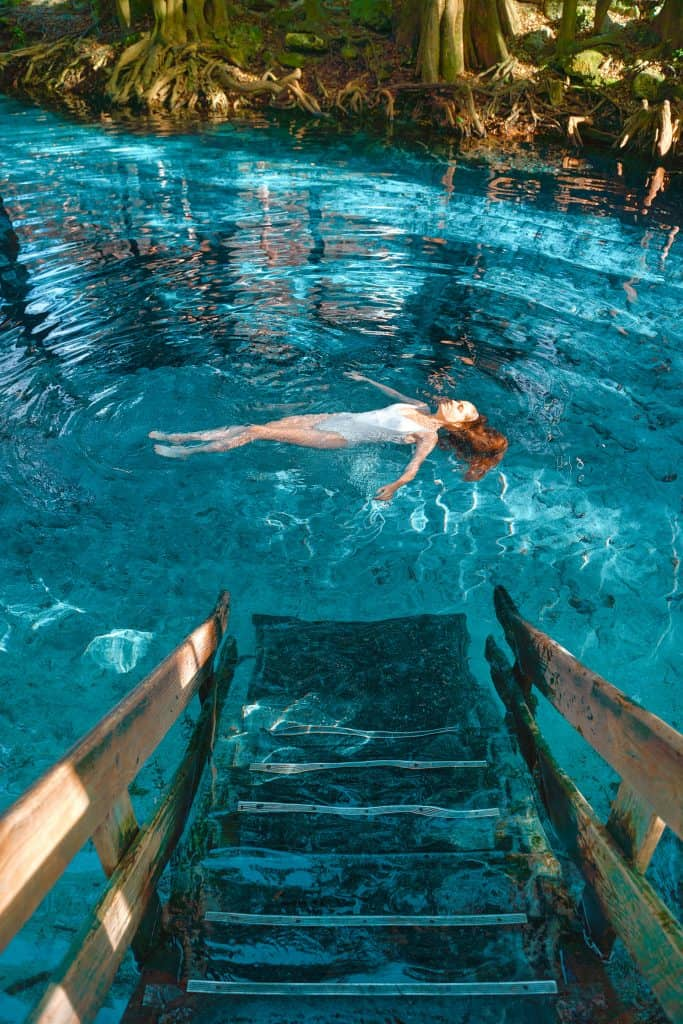 A girl floating in Ginnie Springs a spring near Jacksonville