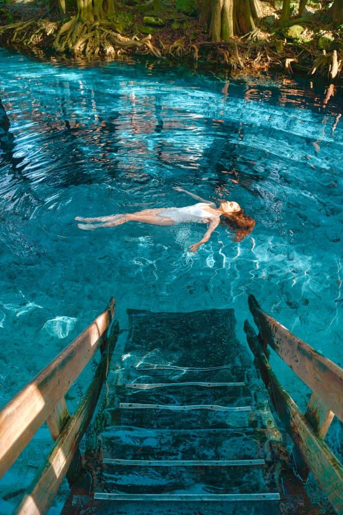 Victoria floats in the waters of Ginnie Springs, her hair undulating underneath her.