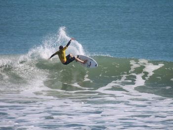 A male surfing in Florida