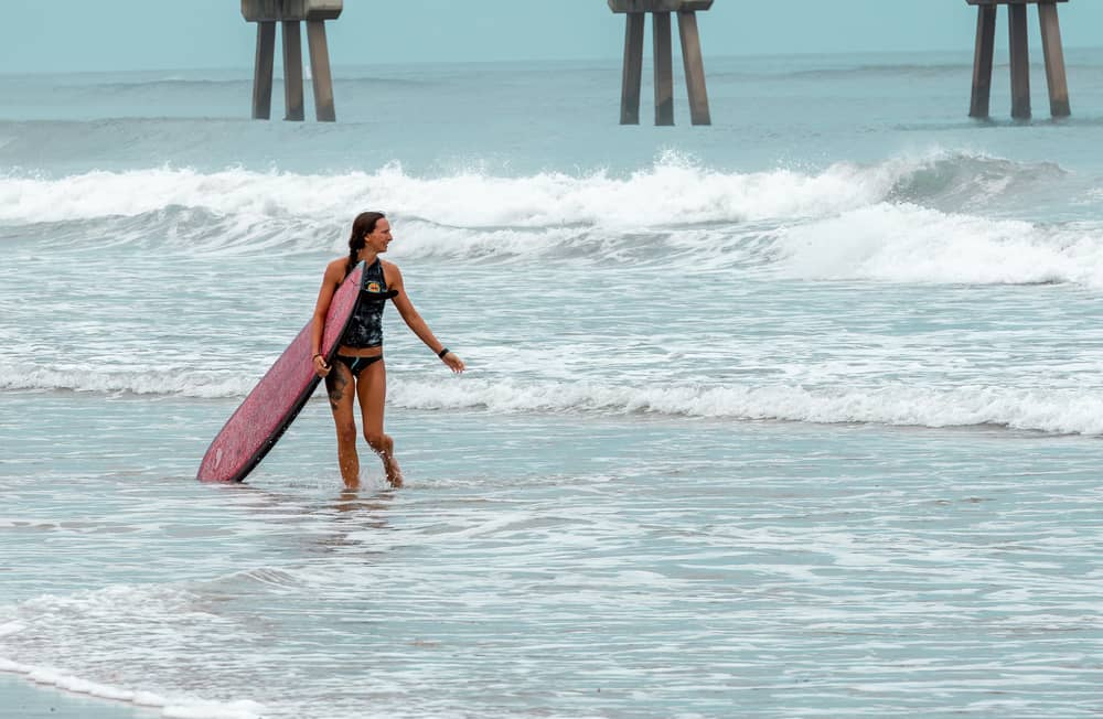 A girl surfing in Florida