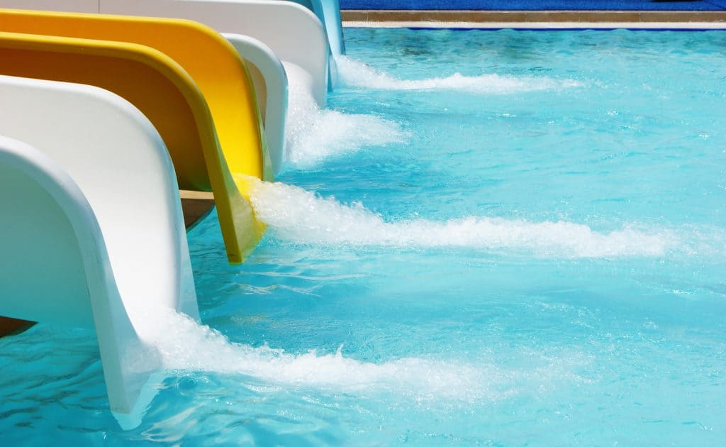 Water slides dump out into a wading pool at Island H20 Live!, one of the best things to do in Kissimmee with kids!