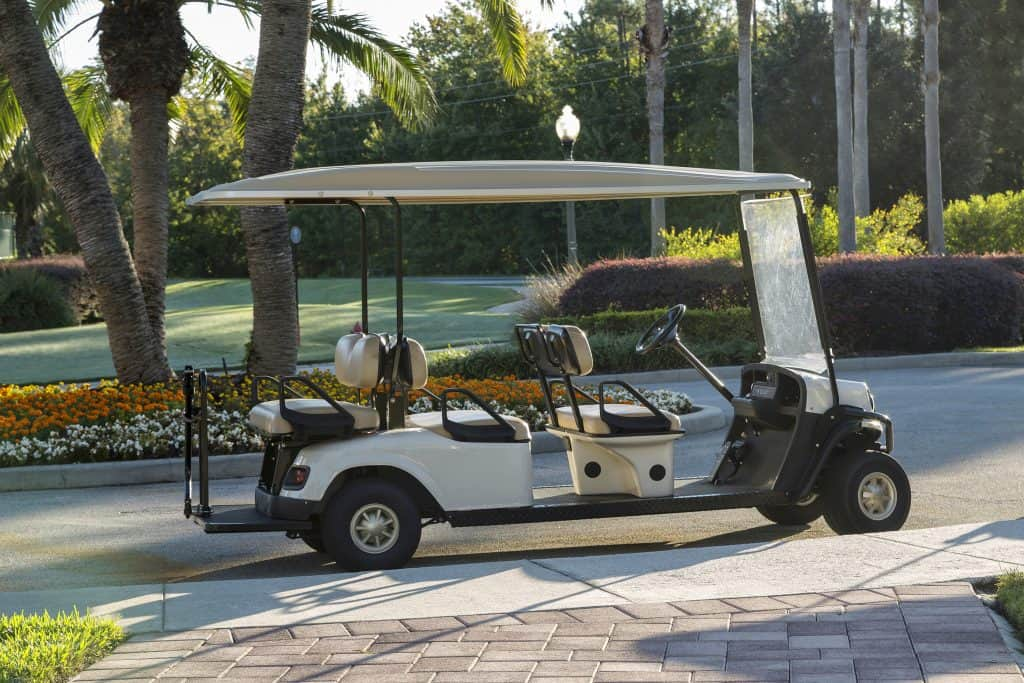 A golf cart sits waiting to take guests to the courses at Oaks National Golf Club.