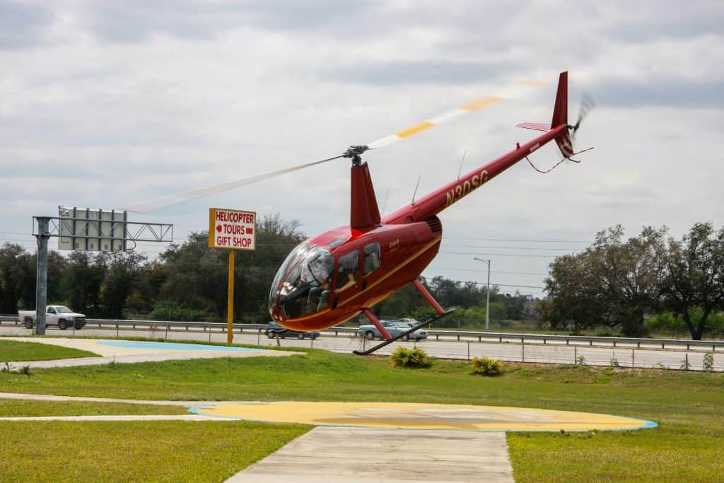 A helicopter lands at Orlando Heli-Tours, one of the best ways to see Kissimmee.