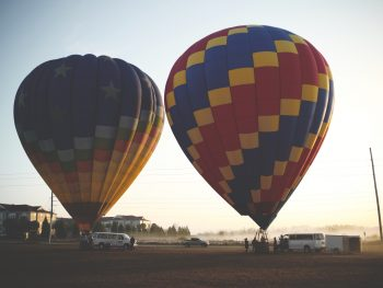 Two air balloons await passengers in the early morning at Thompson Aire, one of the best things to do in Kissimmee.