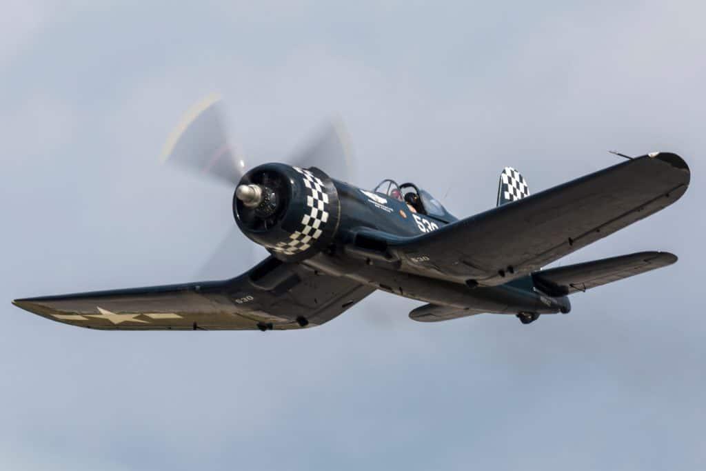 A World War II era plane soars through the skies at War Bird Adventures.