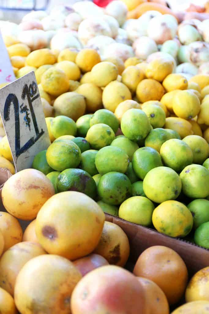 Fresh lemons, limes, and other fruits are stacked neatly at the Marco Island Farmers Market.