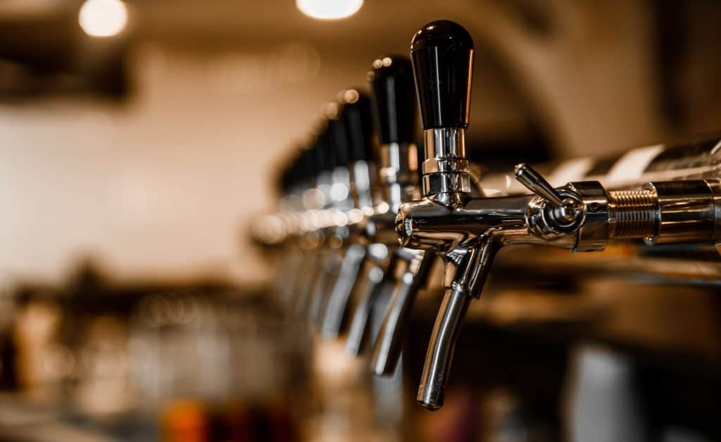 A line of taps wait to be poured at Marco Island Brewing, one of the best things to do in Marco Island.