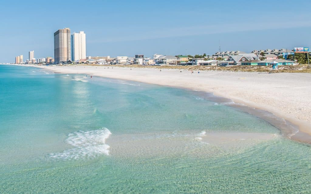 The clear, aqua waters of the Gulf of Mexico wash up on the beach, one of the best things to do in Panama City.