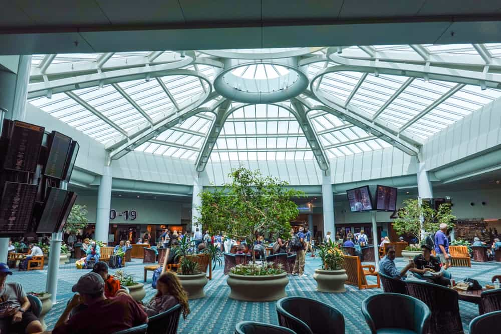 Relax in the large open atrium at Orlando International Airport the most popular airport in Florida