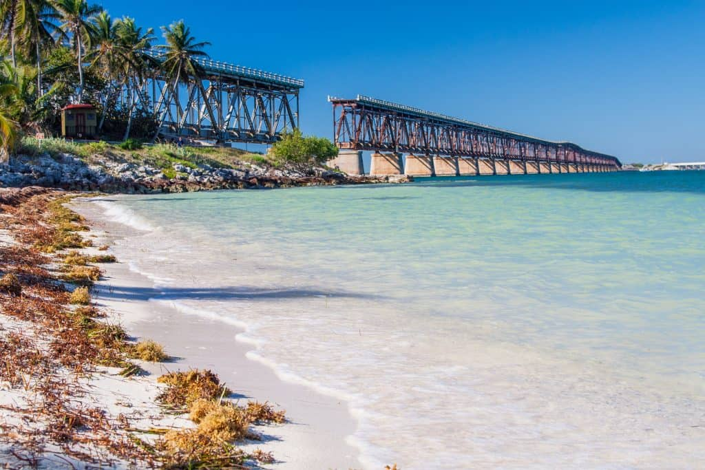 The bridge at Bahia Honda can be seen from the shoreline, a perfect stop on your next Florida road trip.