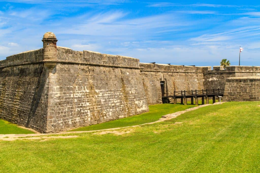 The coquina exterior of the Castillo de San Marcos, a perfect stop on your Florida road trip.