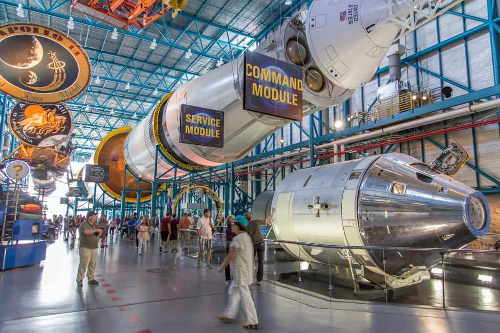 The different modules of a spaceship displayed in the interior of the Kennedy Space Center, one of the best places to visit on your Florida road trip.
