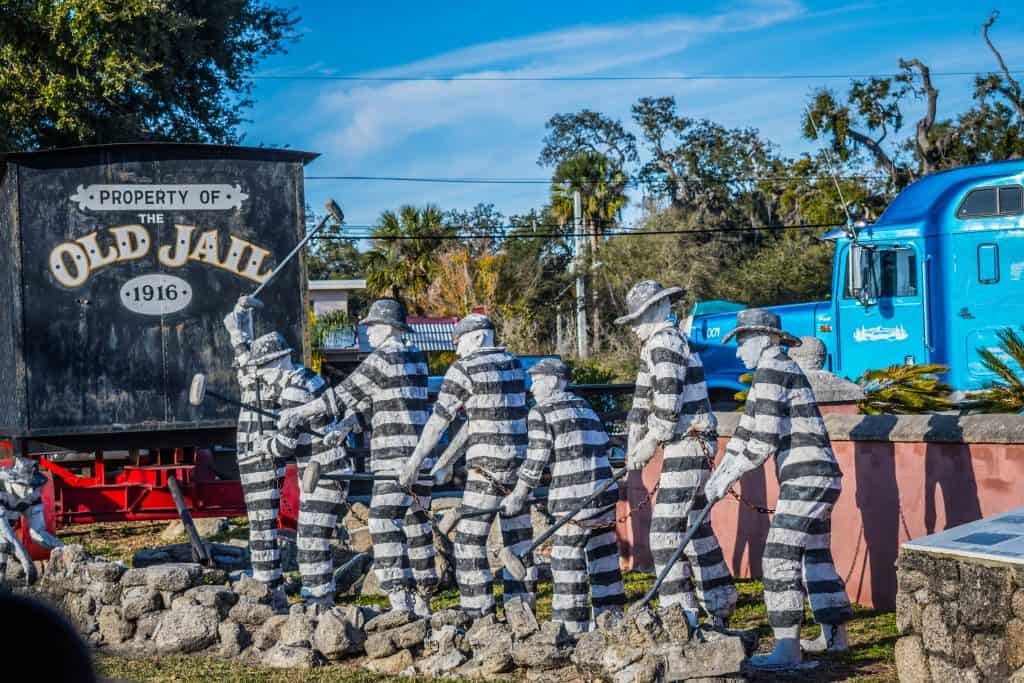 Statues of former jailers work on a chain gang outside of the Old Jail in St. Augustine.