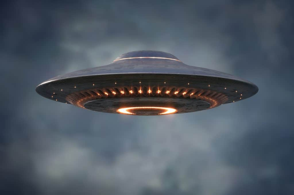 An unidentified flying object hovers in the sky, something you might see on your Florida road trip.