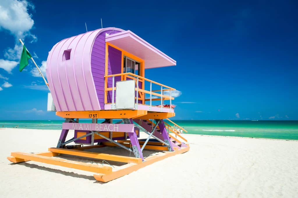 A colorful lifeguard house sits on South Beach, one of the best Miami nude beaches.