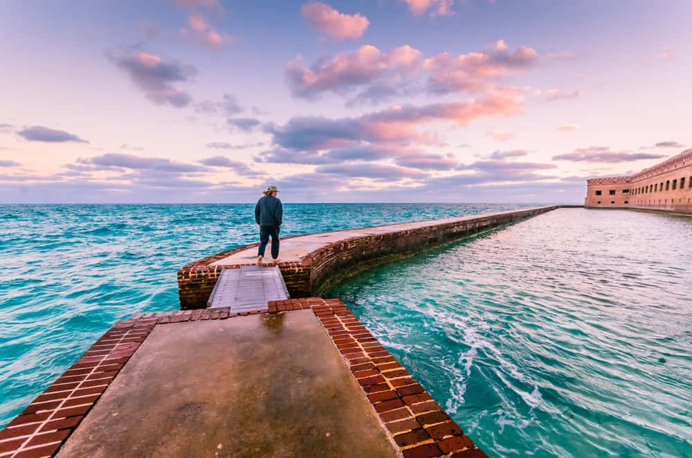Man walking around the wall at Fort Jefferson