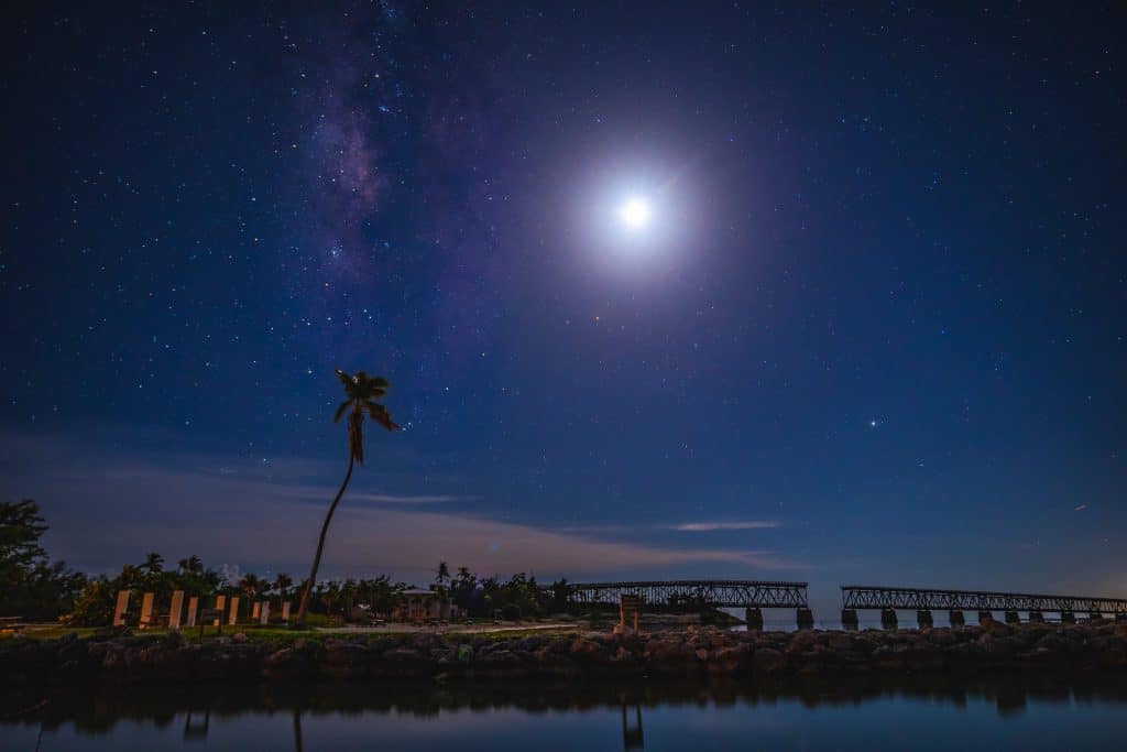 The stars and the moon shine down on Bahia Honda, one of the best places to see stars in Florida.