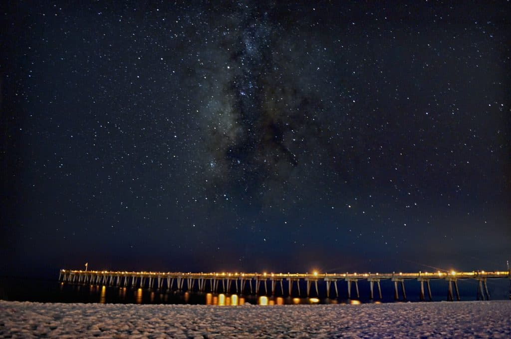 The stars twinkle above Pensacola Beach, one of the best places to go stargazing in Florida.