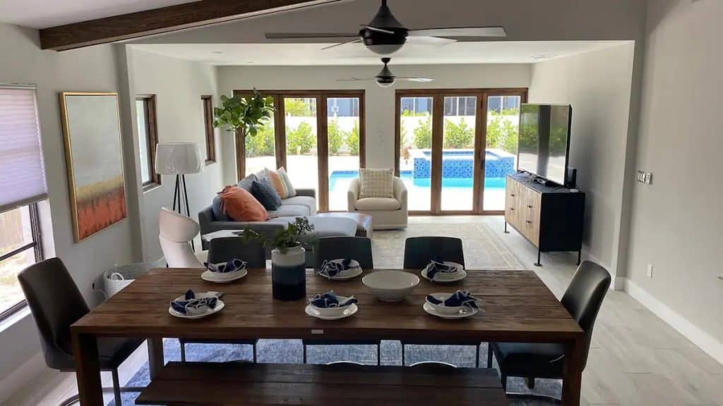Photo of the living room and dining room at an Airbnb close to Vanderbilt Beach.