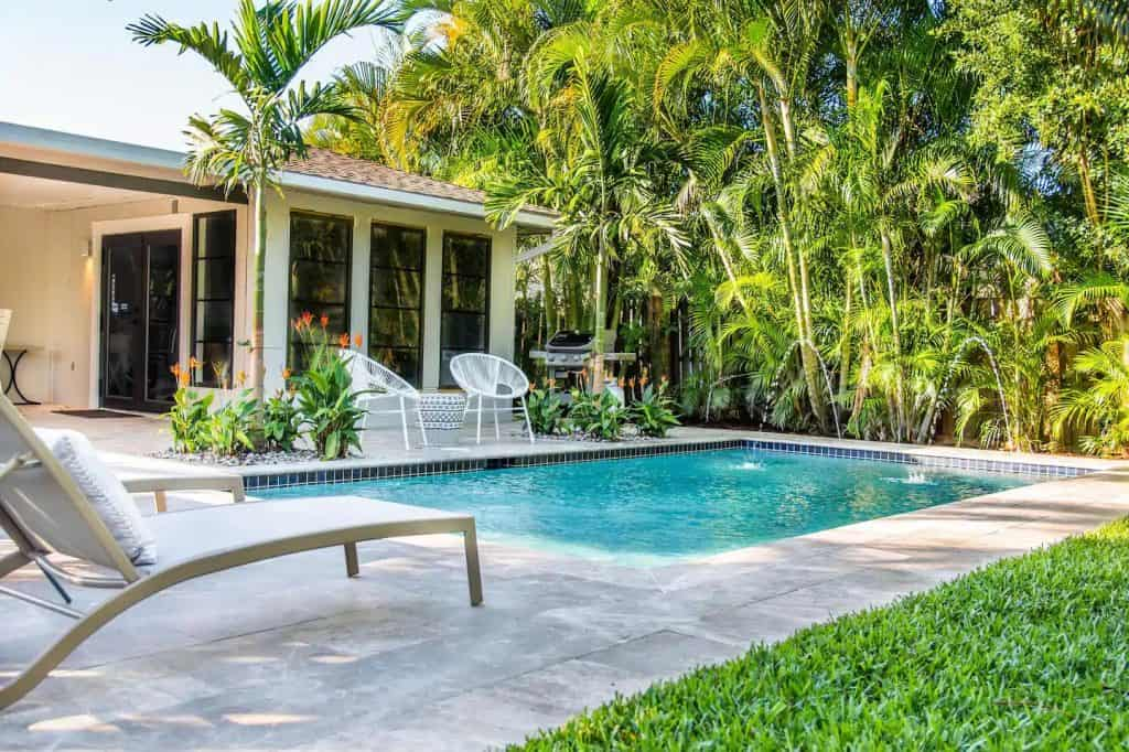 Photo of a lush and tropical backyard with pool at an Airbnb in Florida.