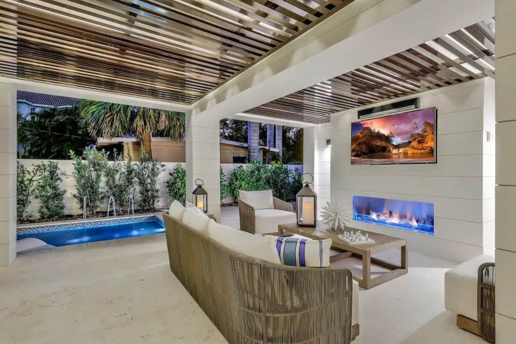 Photo of the lounge area and pool at the Luxe 9th Street Villa Airbnb.