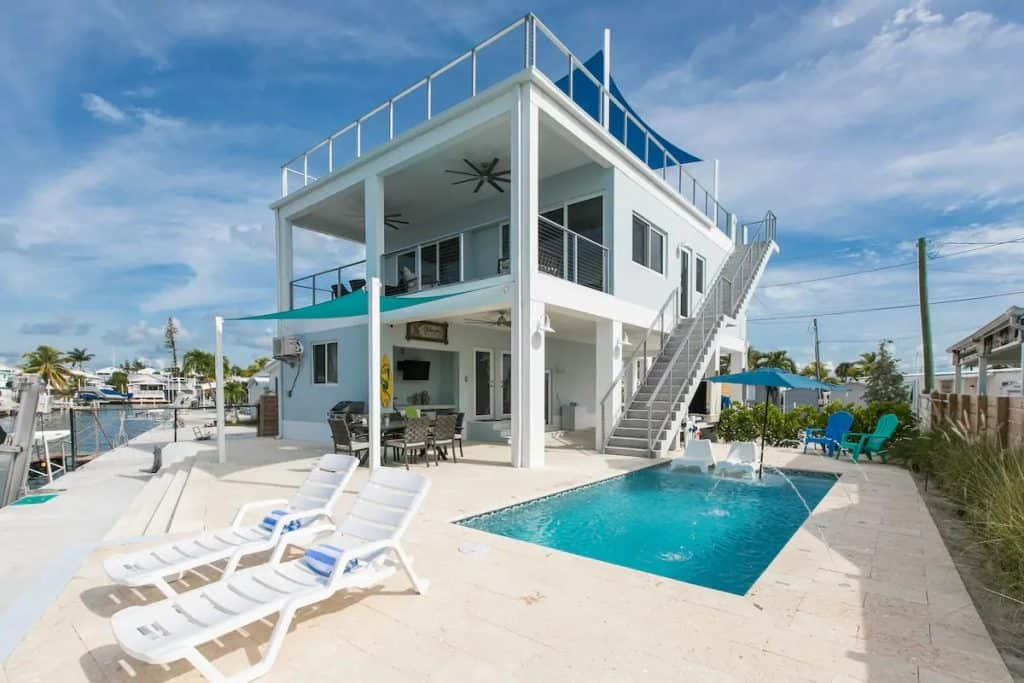 Photo of a 2 story Airbnb in Florida with a pool.