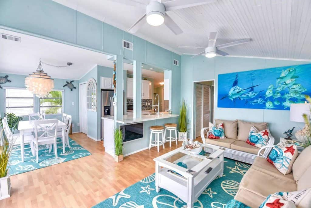 Photo of the tropical themed living room and dining room at an Airbnb named Atlantis.