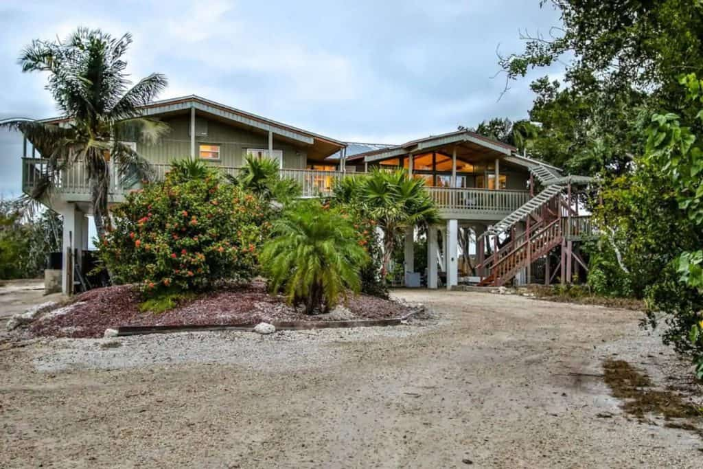 Photo of the exterior of a waterfront home Airbnb in Florida.