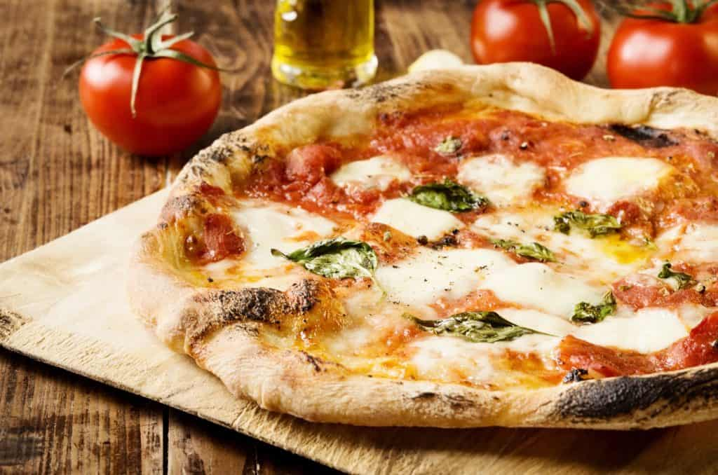 A delicious margherita pizza fresh from the oven from one of the best downtown Tampa restaurants.