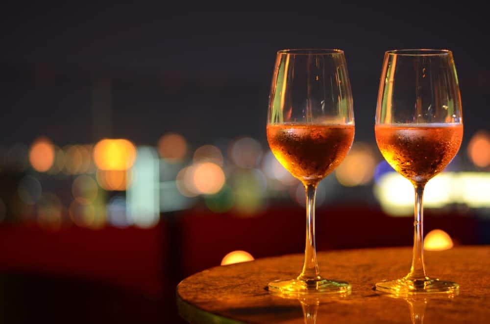 Two glasses of wine against the dark sky